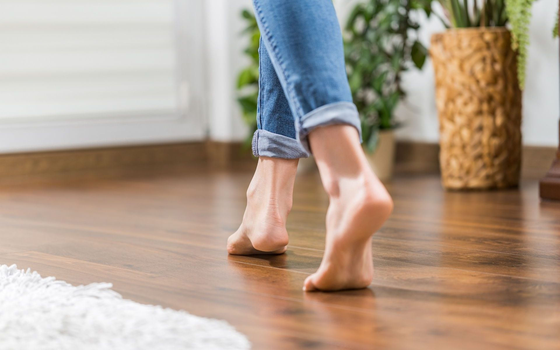 Woman walking on a wooden floor