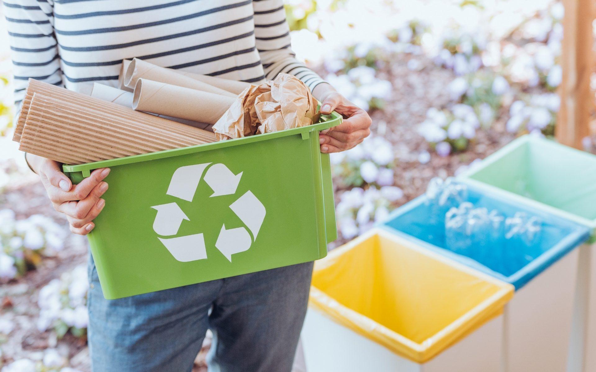 A woman recycling cardboard